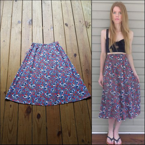 06bbad8c8 @shaggymothvintage. 16 days ago. Wartrace, Bedford County, United States.  Vintage 12West size Medium red and blue floral midi skirt!