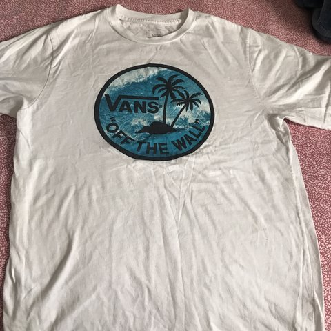 468383cd @lesliexsykes. 2 days ago. Los Angeles, United States. White vans t shirt  with blue detailing