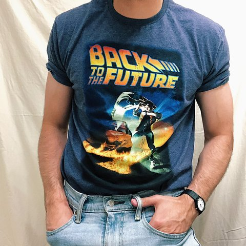 193371db1 @thedwntwnlights. 19 days ago. Turlock, United States. Men's vintage Back  to the Future movie poster T-shirt.