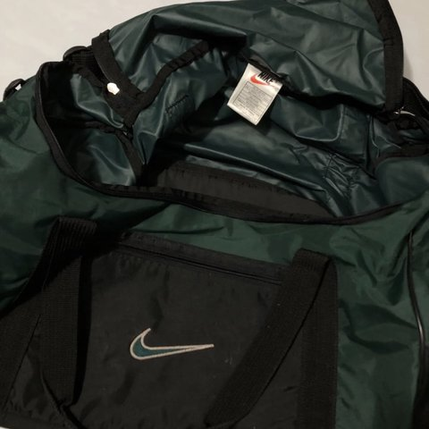 cac431c66 @thriftedbydraco. last month. Carrollton, United States. Vintage 90s Green  Nike Duffle Bag. Dark green with a embroidered logo.