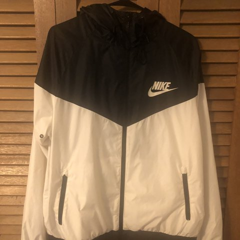 0a36623ef @chadderxcheese. 5 days ago. Seattle, United States. Large black and white  Nike zip-up windbreaker ...