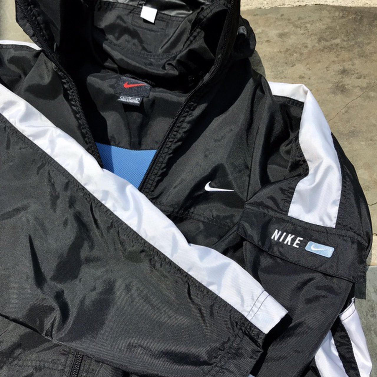 6c621ebe7 @solacecapone. 27 days ago. Temple, United States. Vintage 1990s Black and white  Nike full zip windbreaker jacket ...