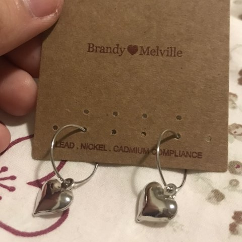 f0f7ff58b @pinkmacaron17. 23 days ago. New Hyde Park, United States. Brandy Melville  Silver Heart Charm Hoop Earrings