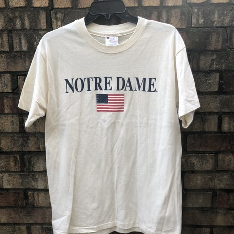 94852ab73e45 @23rd_and_vintage. 10 days ago. Canton, United States. NOTRE DAME CHAMPION  American flag T shirt 🔥
