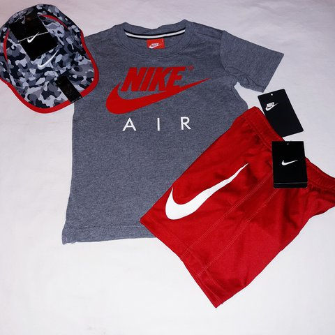 e78697874eba9e Brand new with tags. Nike grey and red printed logo Short a - Depop