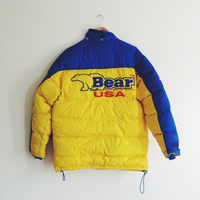 Gear Description. This Bear USA goose down jacket is in fantastic shape with no tears or stains. It's kind of puffy but fits about true-to-size for a men's large.