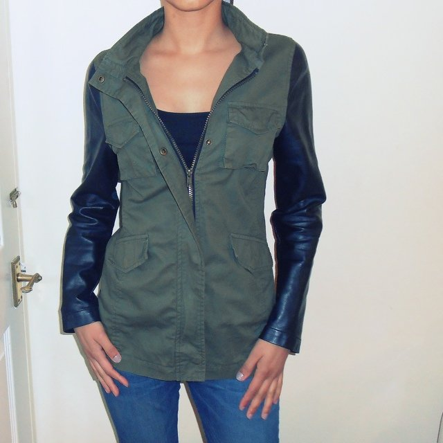 New look army green jacket with leather sleeves. Size 12-13 years however can
