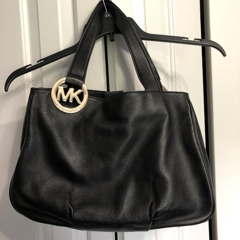 7ac92049ea9995 @esahbellah. 7 days ago. Skokie, United States. Michael Kors Purse Gently  used, in perfect condition! Black leather with gold accents.