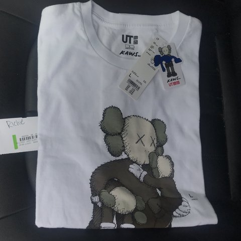 4f61783e5 @rxchie_. last month. Exeter, United Kingdom. Kaws x Uniqlo summer  collection. Holding kid t shirt. Size Large White