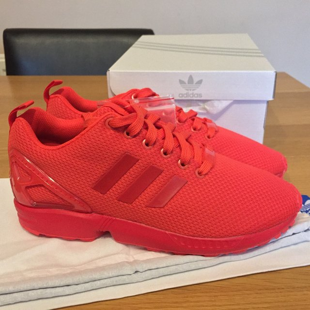 all red zx flux adidas