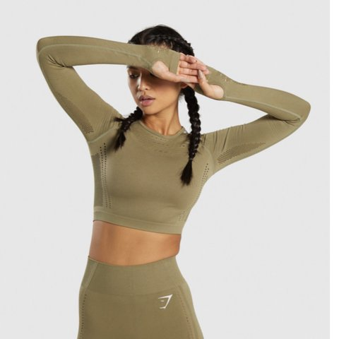 17e17af6494a @moniquealex. yesterday. Enfield, United Kingdom. WOMANS GYMSHARK FLAWLESS  KNIT LONG SLEEVE CROP TOP IN KHAKI GREEN