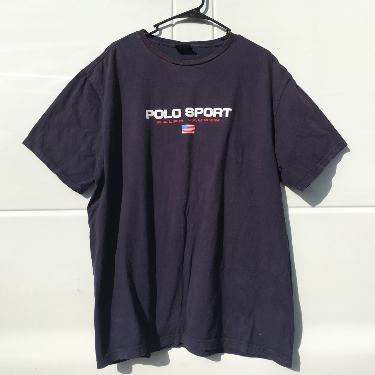 Polo sport t shirt features screen printed for Screen printing polo shirts