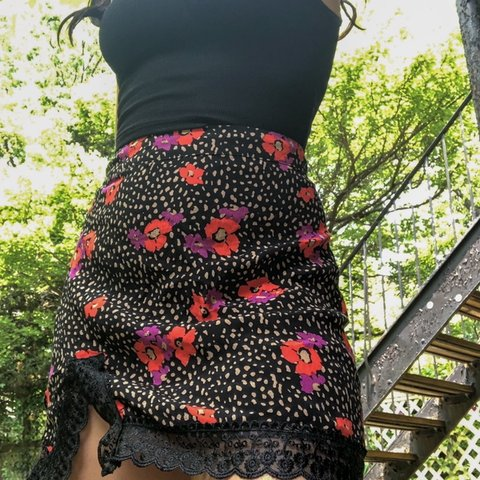 8939766f92a Prettiest floral skirt black with orange and purple flowers - Depop