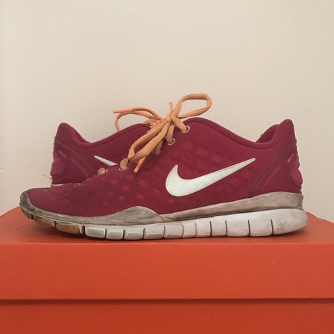 the latest d75ed f0097 pink nike free tr fit shoes w  orange laces - old, worn, as - Depop