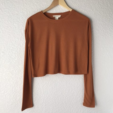 4444223b50c47f @kpjitsu. in 7 hours. Reno, United States. •Forever 21 orange lightweight long  sleeve boxy cropped shirt •Excellent condition