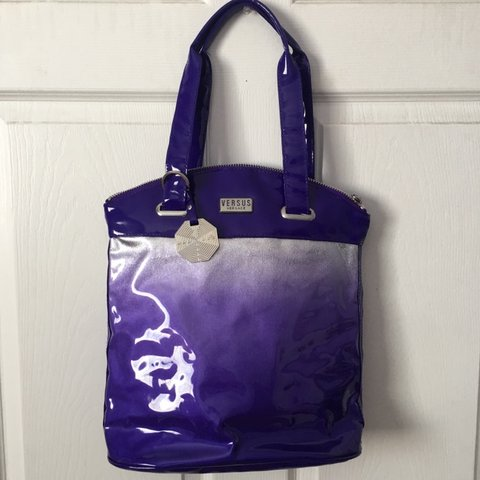 6be084ff19c @laxxra. 14 days ago. Maywood, United States. A Versus by Versace purple + silver  bag !