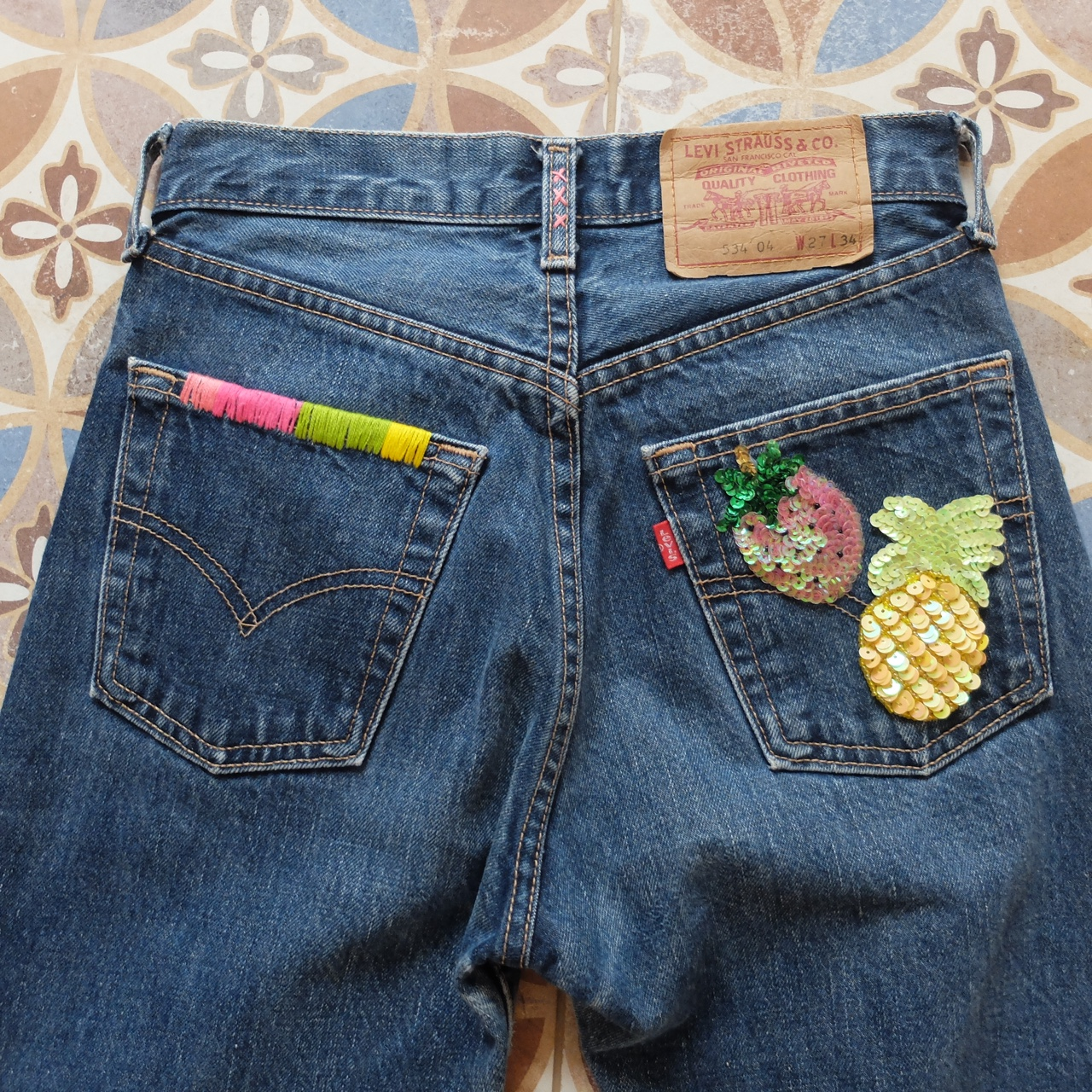 Reworked vintage hand embroidered levi jeans get