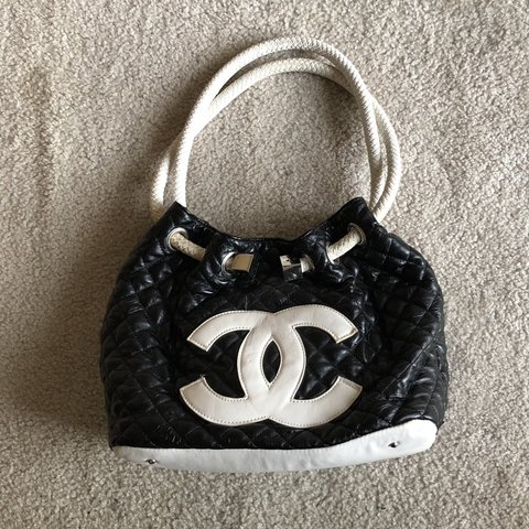 60d13a3f884f @david9lives. in 17 hours. Chicago, United States. Vintage Y2K Chanel Bag  features a quilted pattern huge Chanel logo ...